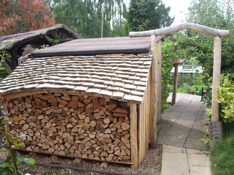 The completed shed is roofed with hand riven sweet chestnut shingles ...